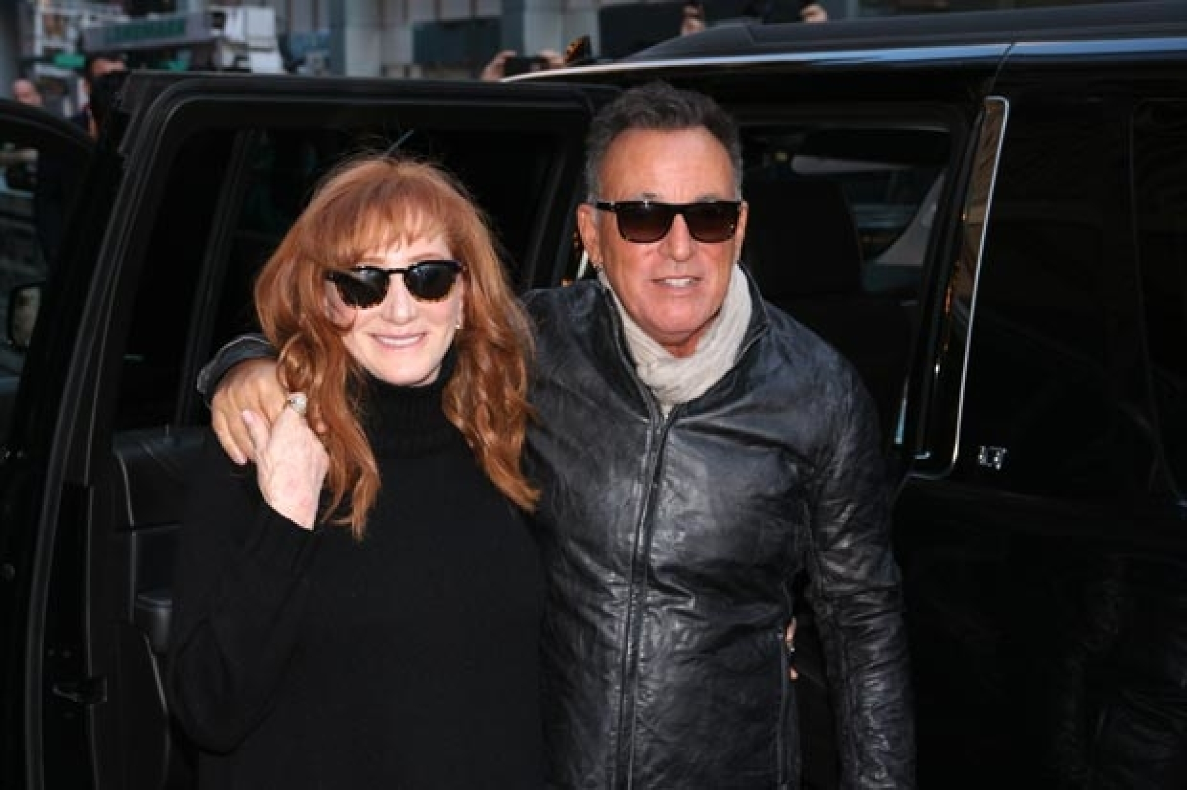 patti scialfa and bruce springsteen pose outside of the