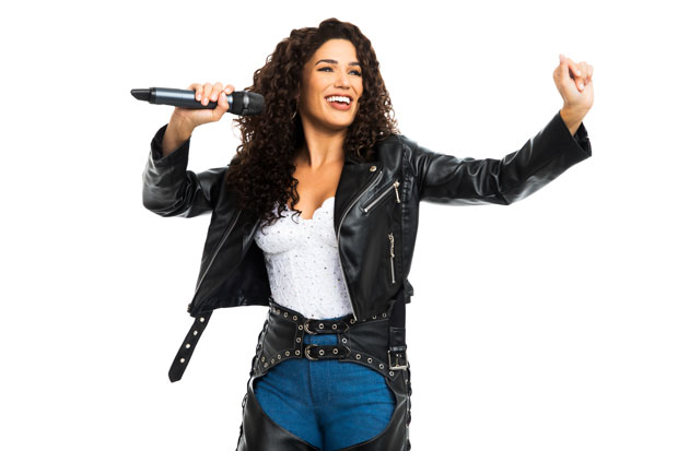 Christie Prades In A Promotional Image For The Tour Of On Your Feet