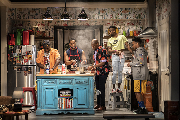 Nicco Annan, Toussaint Jeanlouis, Korey Jackson, Sheldon Best, and Cecil Blutcher star in Katori Hall's The Hot Wing King, directed by Steve H. Broadnax III, at Signature Theatre.